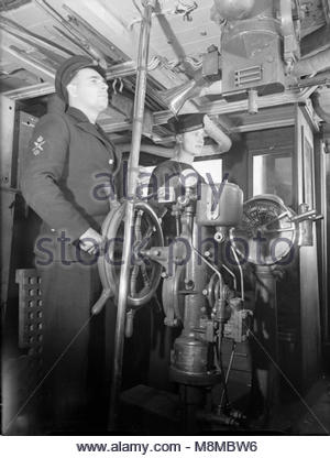 The Royal Navy during the Second World War The coxwain at the wheel of HMS VERVAIN whilst on active service. Another - Stock Photo