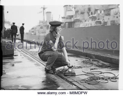 The Royal Navy during the Second World War The Women's Royal Naval Service: A Wren testing a ship's telephone ready - Stock Photo