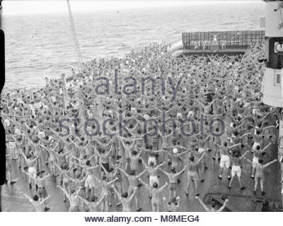The Royal Navy during the Second World War Physical jerks to the music of the Royal Marine Band starts the day well - Stock Photo