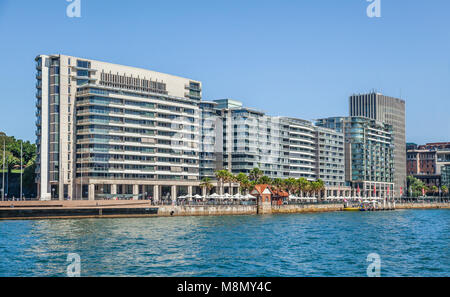 view of East Circular Quay on Sydney Cove with colonaded shops and restaurants, the Colonial Peninsula and Mirvac - Stock Photo