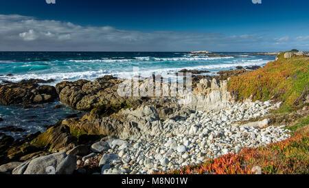 View of the ocean near Pebble beach, Pebble Beach, Monterey Peninsula, California, USA, featuring rocks and ice - Stock Photo