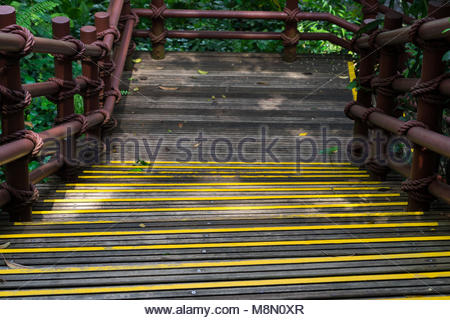 Outdoor yellow painted wooden step stairs in park - Stock Photo