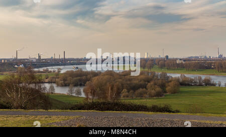 Duisburg, North Rhine-Westphalia, Gemany - March 26, 2016: Werthauser Wardt and the shore of the River Rhine with - Stock Photo