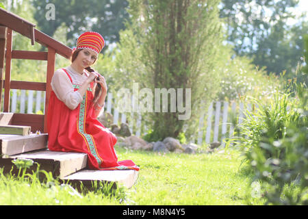 Slav woman in dress traditional - Stock Photo