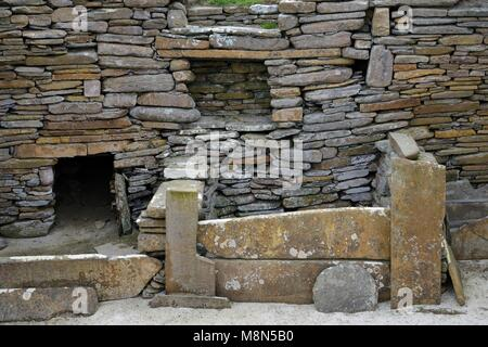 Skara Brae Stone Age Neolithic village at Skaill, Orkney, Scotland. Interior detail of stone box bed and alcoves - Stock Photo