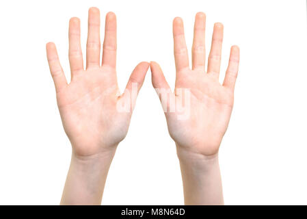Caucasian white girl is showing her hands with open palms on a white background in close-up - Stock Photo
