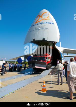AN 124 100 Antonov Volga Dnepr jet airplane unloading, front ramp down, nose up at International Aviation & Space - Stock Photo