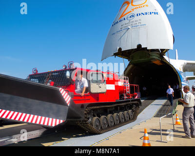 AN 124 100 Antonov Volga-Dnepr unloading the tracked vehicle at International Aviation & Space Salon in Moscow MAKS. - Stock Photo