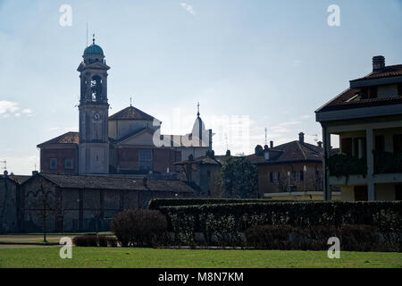 Catholic church, Robecco sul Naviglio, Milan province, Italy, 13 March 2018: Old Catholic church with bell tower, - Stock Photo