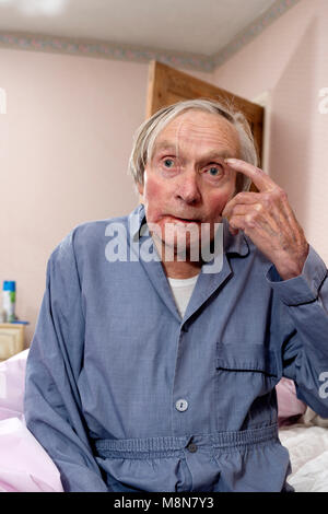 Elderly man getting ready for bed - Stock Photo