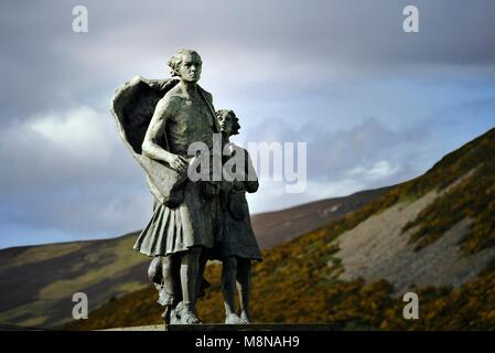 Highland Clearances memorial showing family evicted from glen home. Sited at Helmsdale, Sutherland, Scotland. Created - Stock Photo