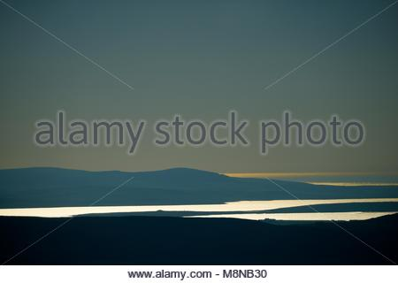 Ness of Brodgar and Ring of Brodgar prehistoric sites on isthmus between Loch of Harray and Loch of Stenness, Orkney. - Stock Photo