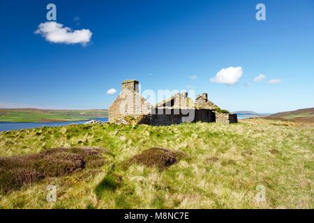 Island of Rousay, Orkney, Scotland. Derelict ruined croft house hill farm near Westness. West over Eynhallow Sound. - Stock Photo