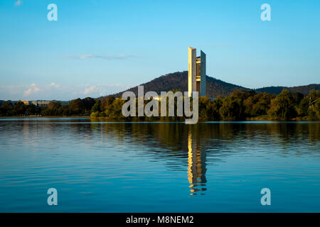 National Carillon, Canberra reflecting into a calm Lake Burley Griffin in the late afternoon sunshine.