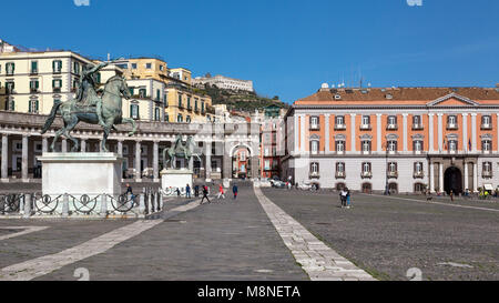 Naples (Italy) - Piazza Plebiscito, the main square in the historic centre of Naples. Two equestrian statues stand - Stock Photo