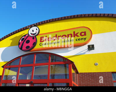 Gorlice, Poland - February 19, 2017: Exterior view of the Biedronka supermarket with the logo situated on the top of the entrance.