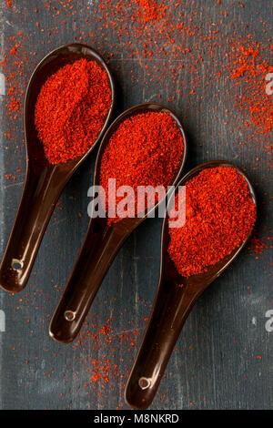 Studio shot of three spoons with paprika powder - Stock Photo