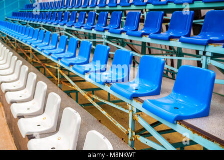 Empty blue stadium seats - Stock Photo