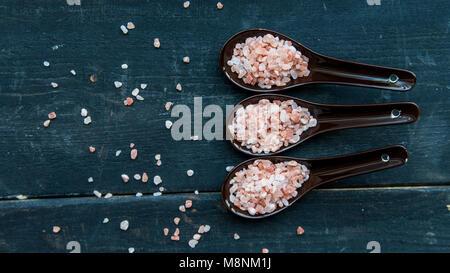 Studio shot of three spoons of pink himalayan salt - Stock Photo