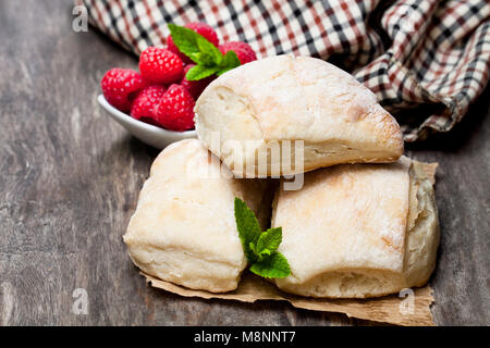 Homemade  fresh sourdough buns with on rustic wooden table - Stock Photo