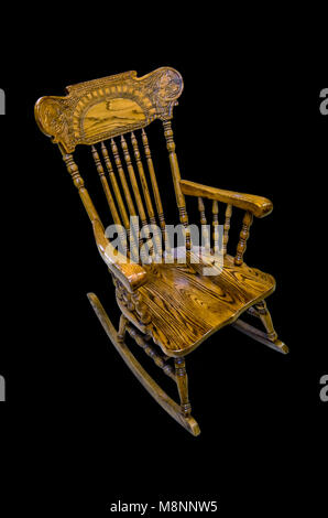 Wooden carved chair rocking brown on a black background, isolated - Stock Photo