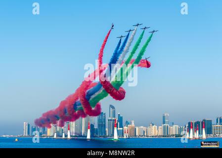 Al Fursan UAE National aerobatic flying display team performing over Abu Dhabi Corniche in the United Arab Emirates - Stock Photo