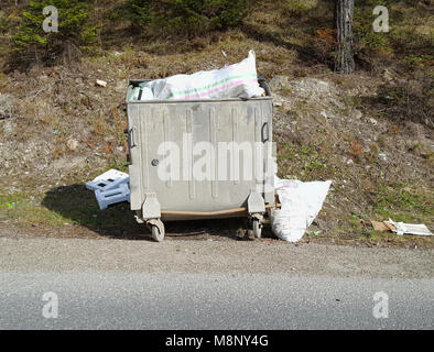 Full dumpster - Stock Photo