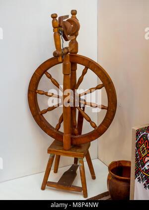 Old Ukrainian wooden distaff to produce of yarn - Stock Photo