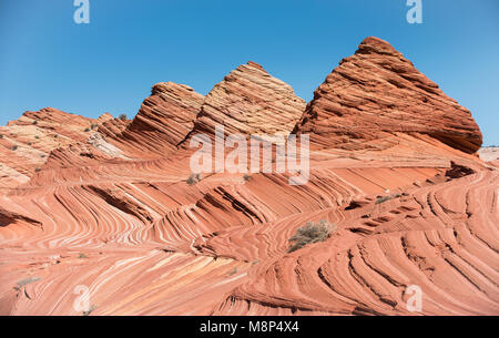 Pyramid shaped sandstone rock formations at Coyote Buttes North, part of the Paria Canyon-Vermilion Cliffs Wilderness - Stock Photo