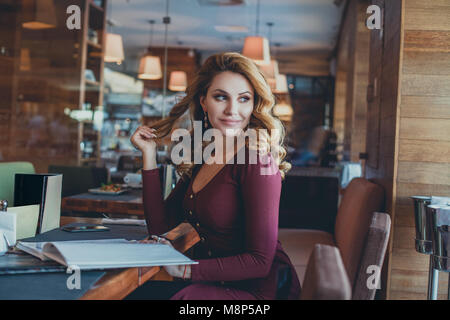 Beautiful Smiling Woman in Cafe. Beautiful Girl Resting in Restaurant - Stock Photo