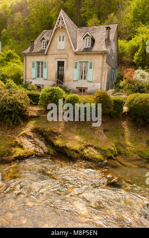 Private home on the banks of the Bouigane river, Saint-Lary, Ariège, France - Stock Photo