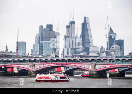 Blackfriars foot bridge in front of the Blackfriars railway bridge over the river Thames, with city of London financial - Stock Photo