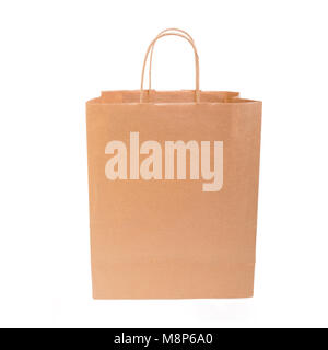 Paper bag with handles on white. - Stock Photo