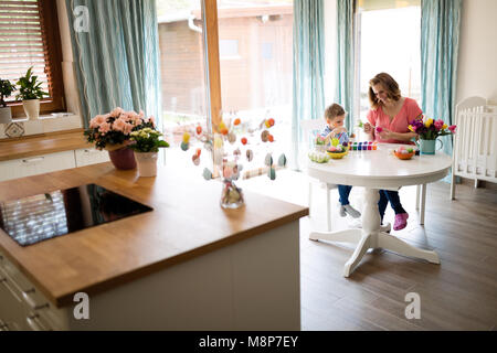 Happy Family Painting Easter Eggs - Stock Photo