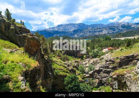 KONYA, TURKEY - JUNE 27, 2017 : Landscape view of entrance of Tinaztepe Caves in Konya, formed with stalagmites - Stock Photo