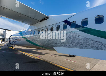 Signatures on the fuselage of a Horizon Air plane at Seattle–Tacoma International Airport, Washington. - Stock Photo