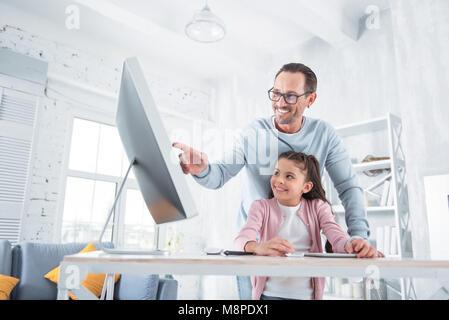Happy smart girl doing the task - Stock Photo