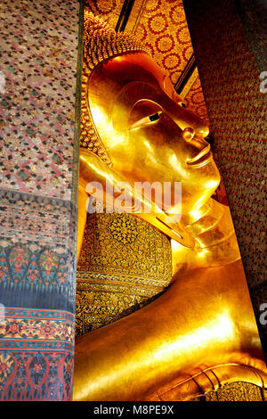 Famous Statue of Big Golden Buddha in wat Pho temple in Bangkok, Thailand - Stock Photo