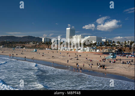 View of Santa Monica beach and downtown area from the Santa Monica pier in Los Angeles, CA - Stock Photo