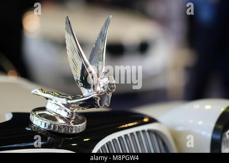 Figure of flying angel on thetop of car hood. Objects at vintage car show - Stock Photo