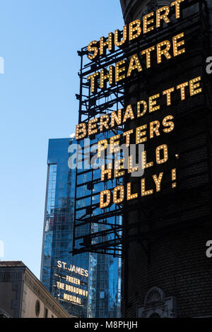 Shubert Theatre Marquee, 'Hello Dolly' with 'Frozen' in the Background, Times Square, NYC - Stock Photo