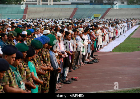 Dhaka, Bangladesh. 19th March, 2018.  Bodies of the 23 Bangladeshi crash victims lined up at the Army Stadium in - Stock Photo