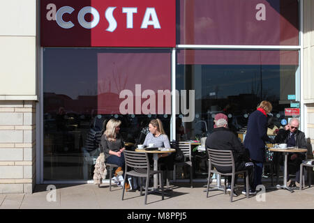 Costa Coffee shop Speke, Liverpool. UK Weather. 19th March, 2018.  Sunny but cold spring day at 8.5C as patrons - Stock Photo