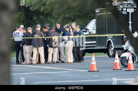 Federal and local law enforcement agencies, including the Austin police, ATF and FBI, investigate at the scene of - Stock Photo