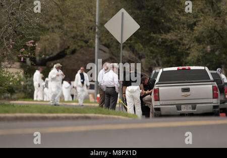 Law enforcement officials work into the afternoon as a fourth package bomb  exploded on a southwest Austin roadside - Stock Photo