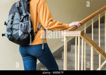 A female student walking up stairs, University of Bath ...