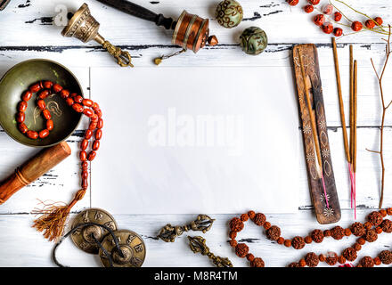 Asian religious musical instruments for meditation and alternative medicine, in the middle a blank white sheet, - Stock Photo