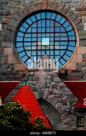 Round window of a stone cathedral in Tampere, Finland - Stock Photo