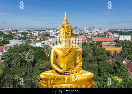 Old Golden buddha statue and cityscape in Thailand - Stock Photo