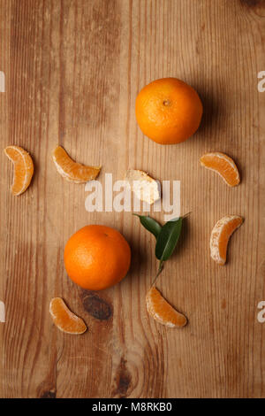 Overhead view of oranges on wooden table - Stock Photo
